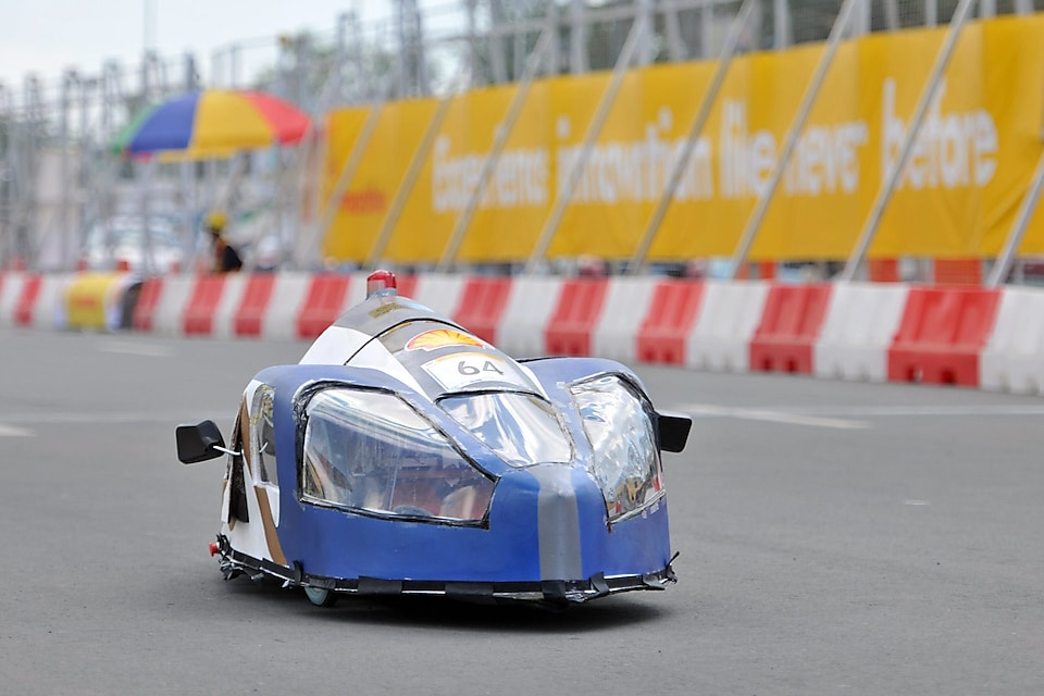 The Mean Machine, #64, Prototype, competing for Team Megalodon from The German University of Technology, Oman seen on the track during day three of the Shell Eco-marathon in Manila, Philippines, Saturday, Feb. 28, 2015.